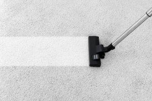 Removing dirt from carpet with vacuum cleaner